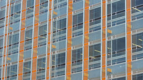 Modern building with glass windows reflected sky Royalty Free Stock Photo
