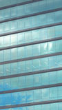 Modern building with glass windows reflected sky Royalty Free Stock Photography