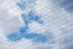 Modern building glass windows with sky reflection Royalty Free Stock Photos