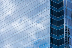 Modern building glass windows with sky reflection Royalty Free Stock Images