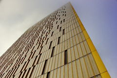 Modern building going into the sky in a foggy day Royalty Free Stock Photography