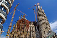 Modern building and gothic temple. Stock Photos