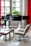 Modern building and grand piano Royalty Free Stock Images