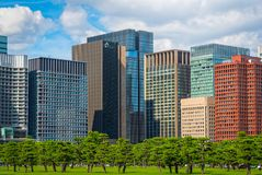 Modern building with green Zen garden on blue sky background in. Tokyo, Japan royalty free stock photos