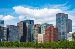 Modern building with green Zen garden on blue sky background in. Tokyo, Japan stock images