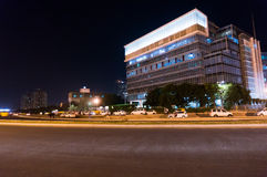 Modern building in Gurgaon. Gurgaon, India; 19th Sept 2015: Modern office building in Cyberhub Gurgaon delhi with cars parked in front Stock Images