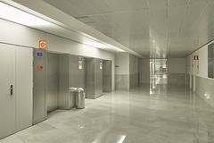 Modern building interior elevators area with marble floor. Architecture royalty free stock images