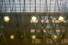 Modern building interior glass ceiling. With lights and skyscrapers in background Royalty Free Stock Photos