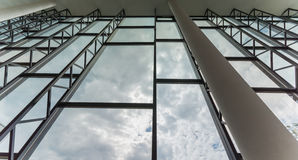 Modern building interior. Office building. Big bright windows. Stock Photos