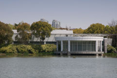 Modern building on a lake in Century Park Shanghai Royalty Free Stock Images