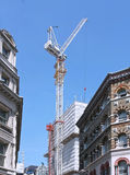 Modern building. Large modern building construction crane in old part of London Stock Photo