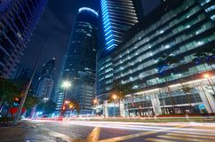 Modern building with light trails stock images