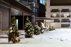 Modern building made of glass and concrete Narva. Modern building made of glass and concrete amidst a snowy winter landscape at night. Severe Northern winter and stock photo