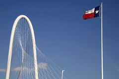 The Margaret Hunt Hill Bridge Texas state flag. Modern building The Margaret Hunt Hill Bridge and Texas state flag at city Dallas USA stock image