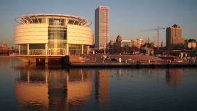 Modern building on Milwaukee, Wisconsin waterfront stock footage