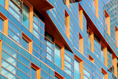 Modern building mirror facade in blue tone Royalty Free Stock Images