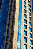 Modern building mirror facade in blue tone Stock Photo