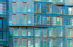 Modern building mirror facade in blue tone Royalty Free Stock Photography