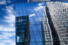 Modern building with mirrored blue sky Royalty Free Stock Photography