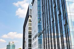 Modern building.Modern office building with facade of glass Royalty Free Stock Photos
