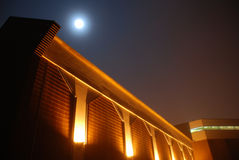 Modern Building in Moonlight and Fog. This nightscape captured with a full moon on a restless foggy night in Northern Idaho Royalty Free Stock Photo