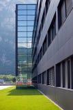 Modern building among mountains Stock Photo