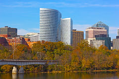 Modern building near Potomac River surrounded by trees with fall foliage. Stock Image