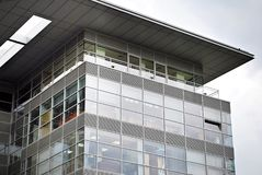 Modern building. Modern office building with facade of glass Royalty Free Stock Photo