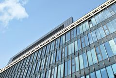 Modern building. Modern office building with facade of glass Stock Image