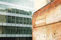 Modern building and old brick wall. Facade of modern building and old brick wall Stock Image