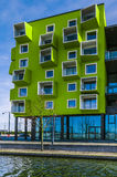 Modern building. Painted green with different shapes of balconies Royalty Free Stock Images