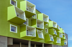 Modern building. Painted green with different shapes of balconies Stock Image