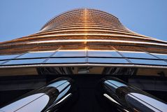 Modern building. Panoramic and perspective wide angle view to steel blue background of glass high rise building skyscrapers in modern futuristic downtown at Stock Image
