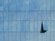 Modern building with reflections from the sky and  opened window Royalty Free Stock Image