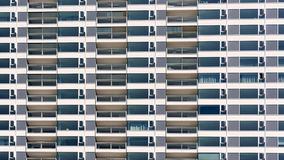 Modern building. Repeating pattern of windows on new modern apartment building Royalty Free Stock Photo