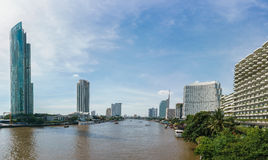 Modern building between the river in Bangkok Thailand Royalty Free Stock Photo