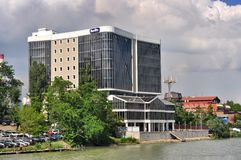 Modern building on the river banks Stock Photo