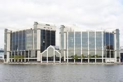 Modern building by the riverside Stock Images