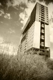 Modern building in sepia tone out of focus Stock Photo