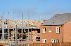 Modern Building Site constructing modern homes. Houses under construction at a modern building site in England, United Kingdom Royalty Free Stock Images