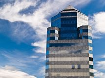 Modern building in the sky. Modern building with an amazing sky Royalty Free Stock Photo