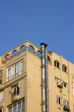 Modern building with smoke stacks. And clear blue sky Royalty Free Stock Image