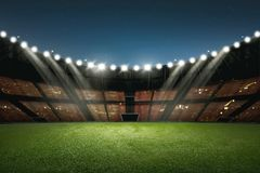Modern building of soccer stadium with illumination. On the night stock images