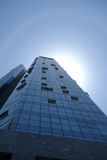 Modern building with solar halo. Under blue sky in China Royalty Free Stock Images