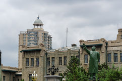 Modern building with The statue Chairman Mao Tse Tung Royalty Free Stock Image