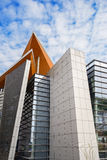 Modern building towering in cloudy sky Stock Photography