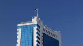 A modern building with a Ukrainian flag on the roof Stock Photography