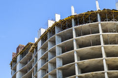 Modern building under construction against blue sky. Constructio Royalty Free Stock Photo