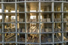 Modern building under construction detail, concrete frame, window openings and scaffolding background.  royalty free stock image