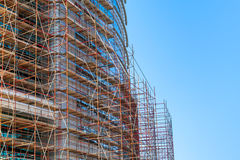 Modern building is under construction, metal scaffolding Stock Photo